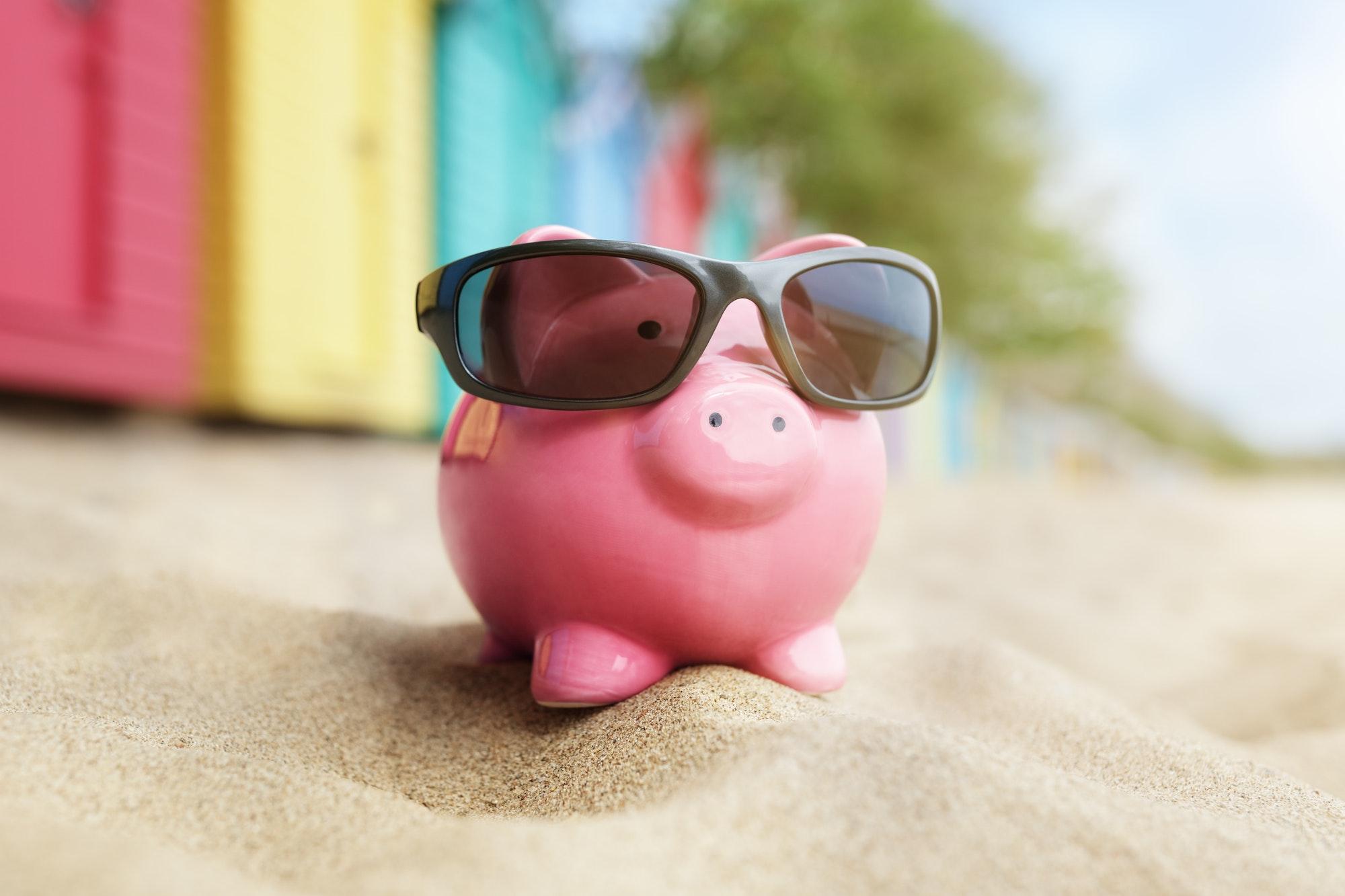 Piggy bank on beach vacation